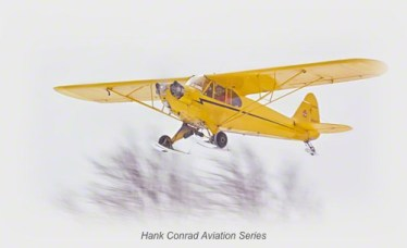 Piper Cub Flying in Snow