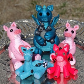 Polymer family made of polymer clay, Swarovski crystals and glass beads