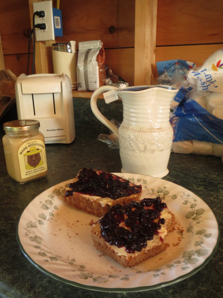 blueberry jam and butter on fresh bread