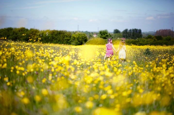 Kids in buttercup field
