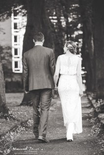 Bride & Groom walking black & white