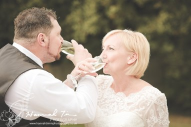 Bride & Groom with champagne