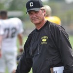 Kurt Russell as Coach Hand