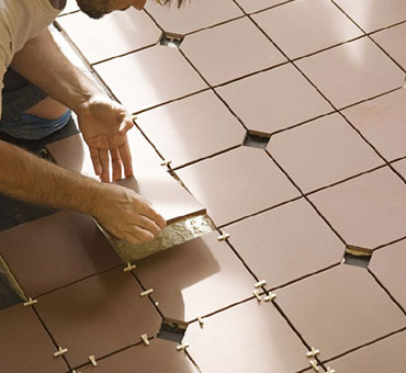 how long to wait to walk on floor tile