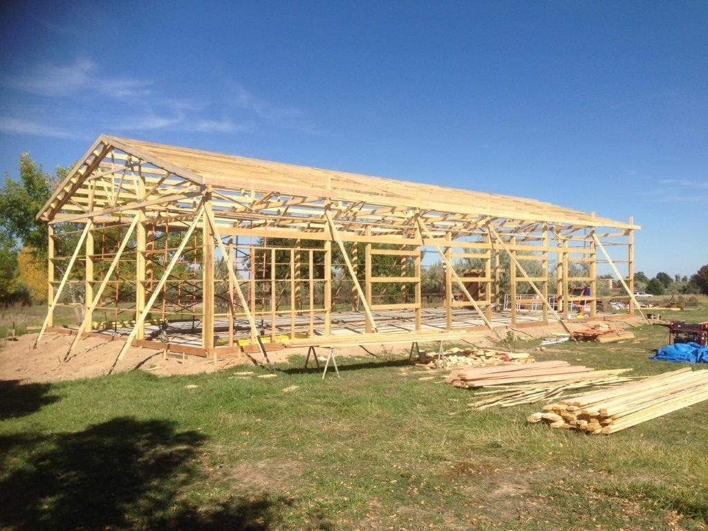 hight resolution of  a building characterized by primary structural frames of wood posts as columns and trusses or rafters as roof framing roof framing is attached to the