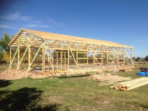 small resolution of  a building characterized by primary structural frames of wood posts as columns and trusses or rafters as roof framing roof framing is attached to the