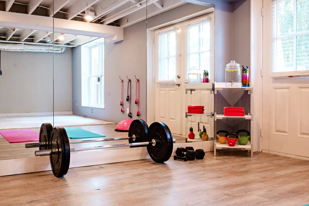 Home Gym Ideas and Renovation featured by popular Atlanta fitness blogger Happily Hughes