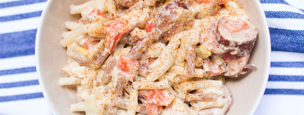 This Creamy Chicken & Sausage Cajun Pasta is gluten free and dairy free- perfect for lunch or dinner!   read more at happilythehicks.com