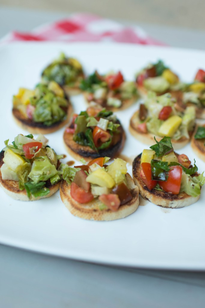 Summertime Veggie Bruschetta   The perfect appetizer for your next summer dinner party!   read more at happilythehicks.com