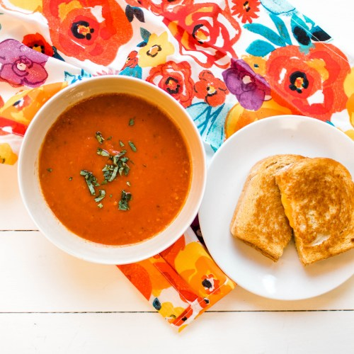 Yummy homemade tomato soup- perfect for a cold winter's night!   read more at happilythehicks.com