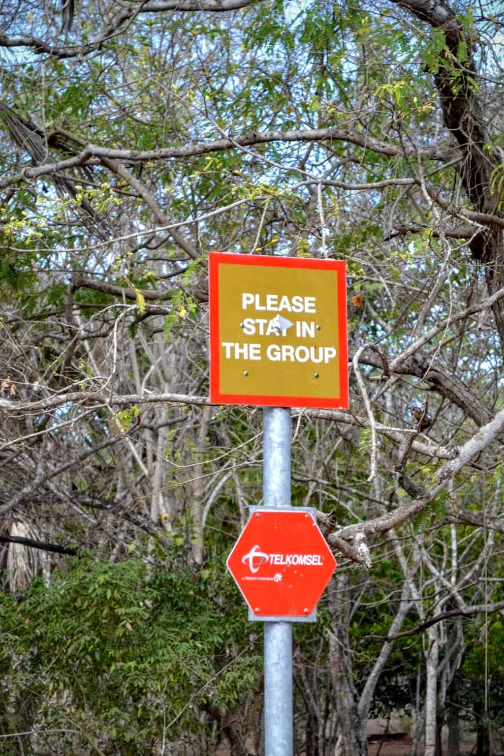 Warning sign to stay in the group