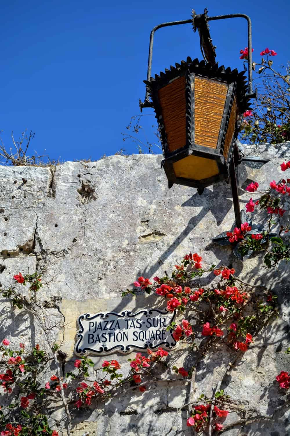 A lantern and street sign in Mdina