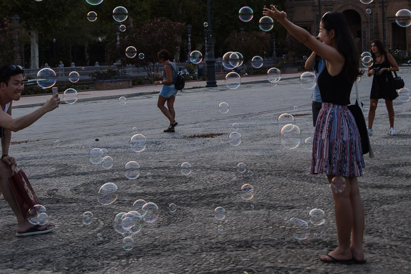 Visitors playing with bubbles