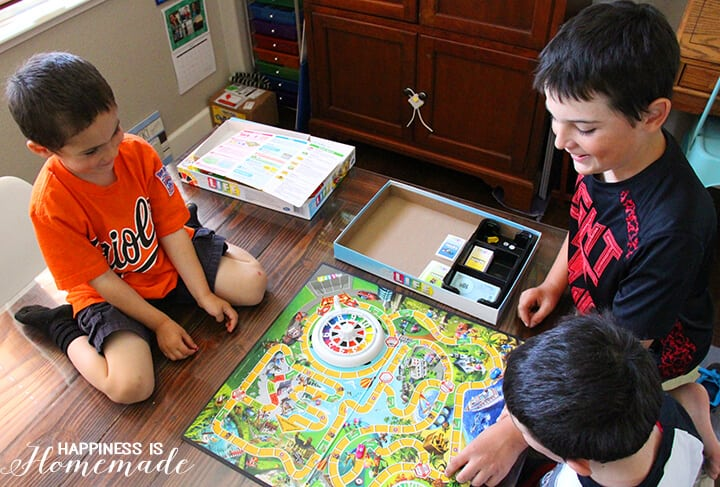 Boys Playing the Game of Life Game