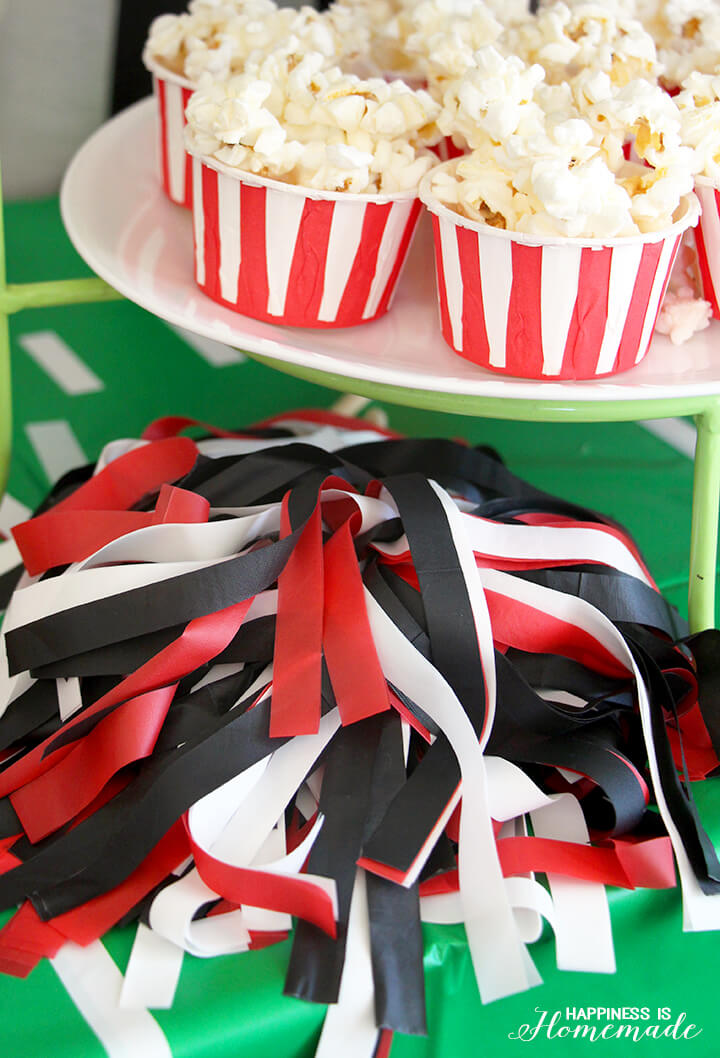 Decorate the Football Party Table with DIY Pom Poms in Team Colors