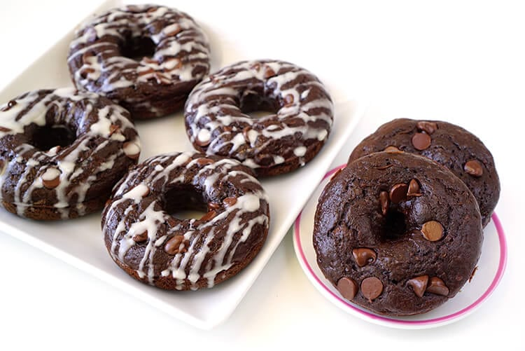 Double Chocolate Zucchini Healthy Donuts - These better-for-you double chocolate donuts are under 100 calories each! A moist and rich chocolaty indulgence that won't blow your diet!