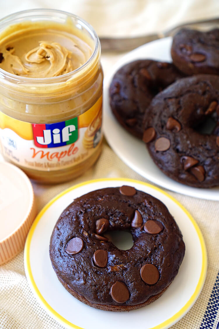 Top Double Chocolate Donuts with Maple Peanut Butter Jif Spread