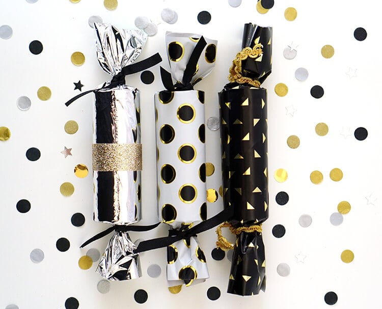 Make your own DIY New Year's Eve party crackers and fill them with confetti, balloons, paper crowns, noisemakers, and more! TONS of fun for all ages!