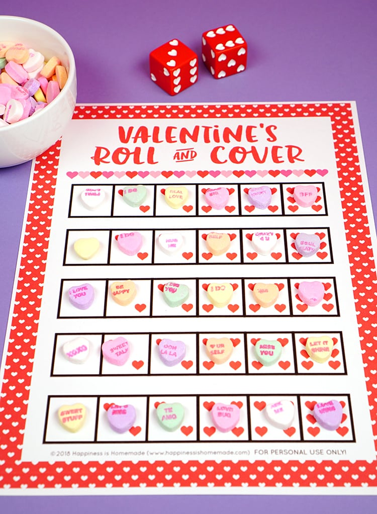 Looking for a fun and easy Valentine's Day game for your classroom, family, church, or playgroup? This Roll & Cover Valentine Game is fun for kids of all ages! Use our free printable valentines game and race to be the first to cover all of the dice with candy hearts!