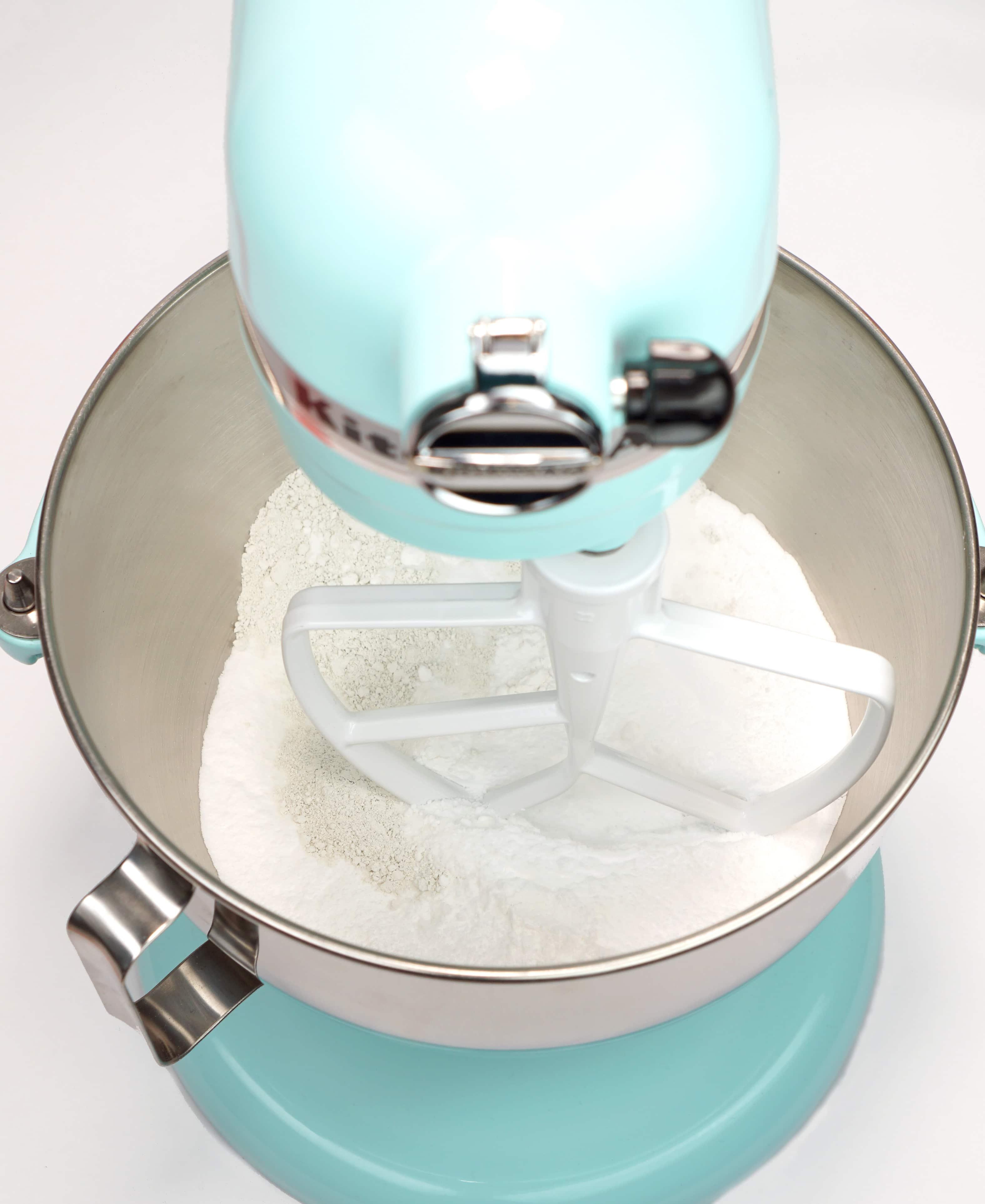 Bath bomb dry ingredients in aqua stand mixer