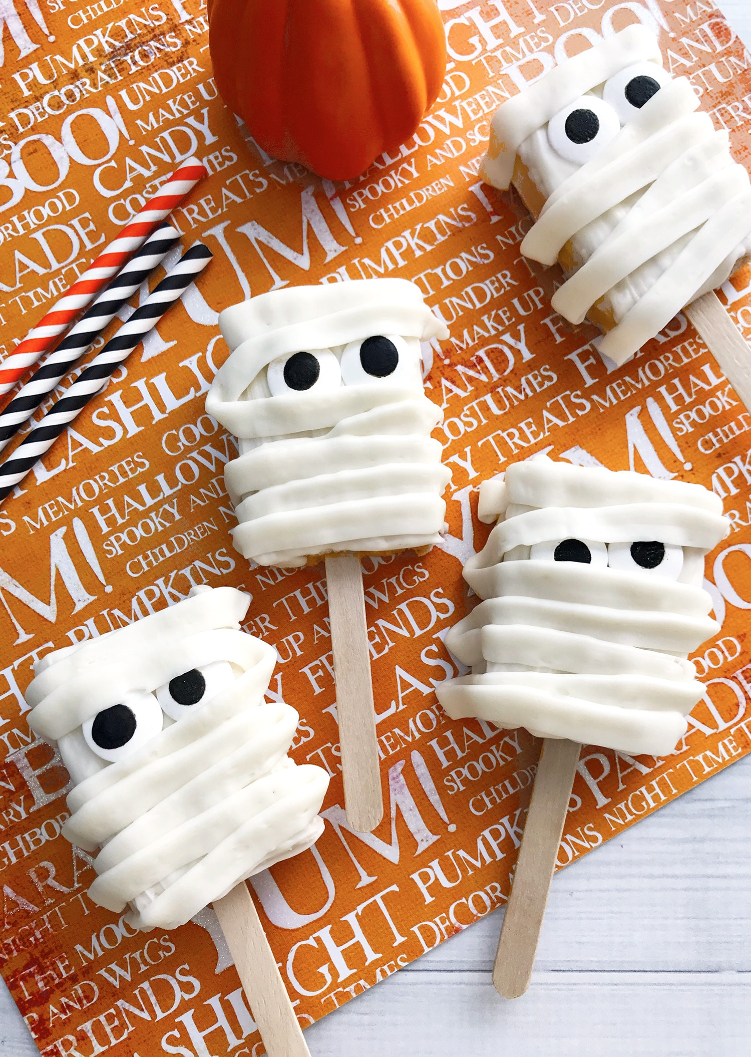 Mummy Rice Krispies Treats on an orange Halloween background