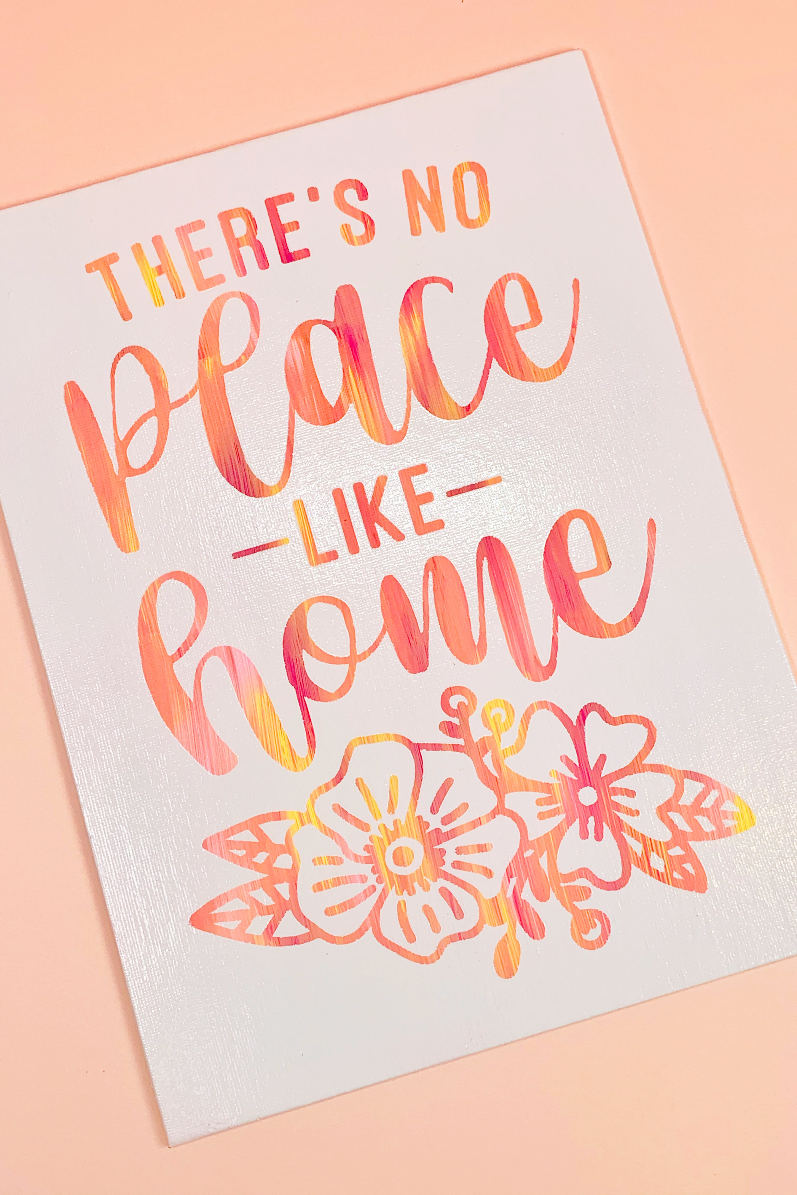 """Completed white hot mess canvas with sunset-hued """"There's No Place Like Home"""" quote"""