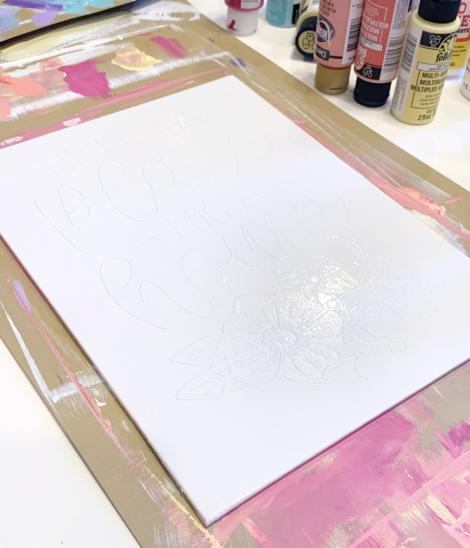 White spray painted canvas with vinyl design