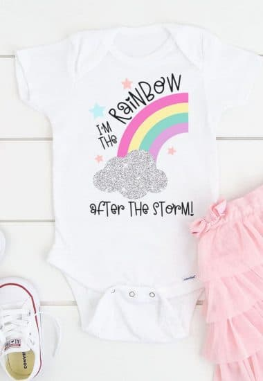 "Baby bodysuit with ""I'm the Rainbow After the Storm"" design surrounded by a pink tutu and white shoes"