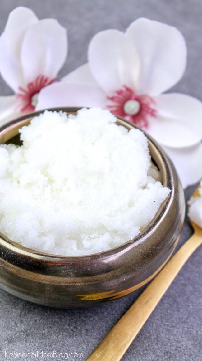 A close up of a jar of cotton blossom sugar scrub