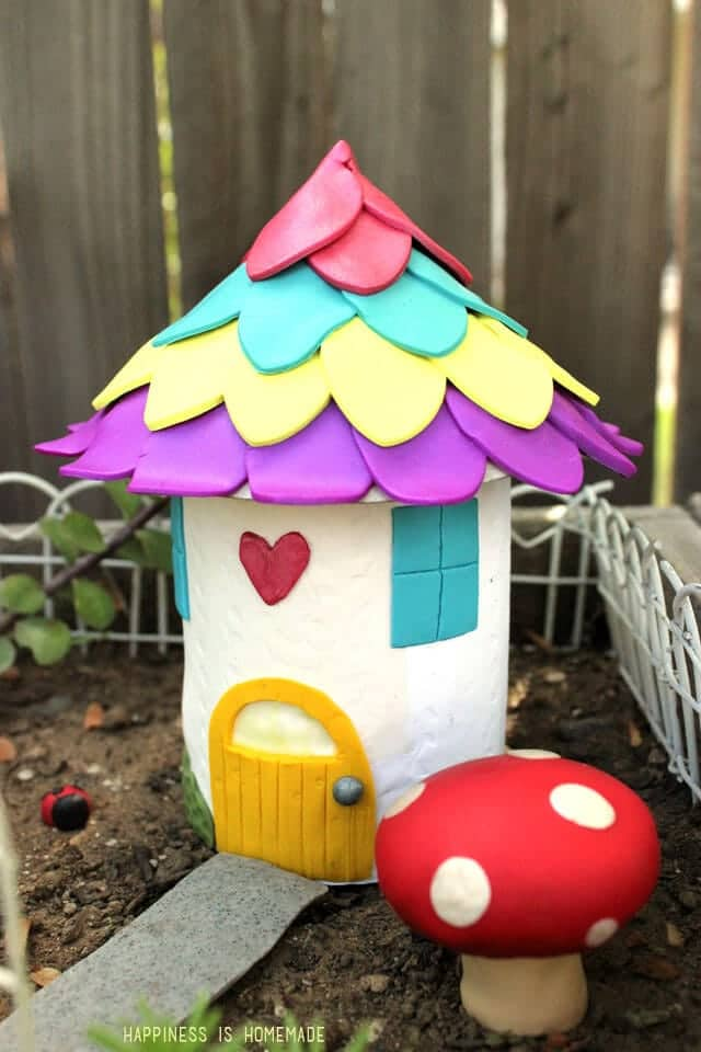 Colorful fairy garden house made from recycled can and polymer clay
