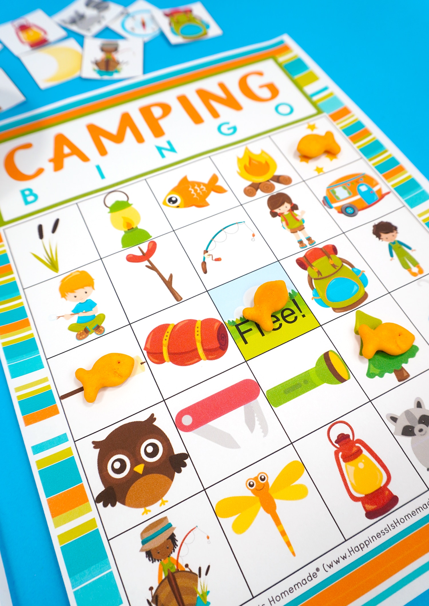 Close up of camping bingo game card and Goldfish cracker game markers