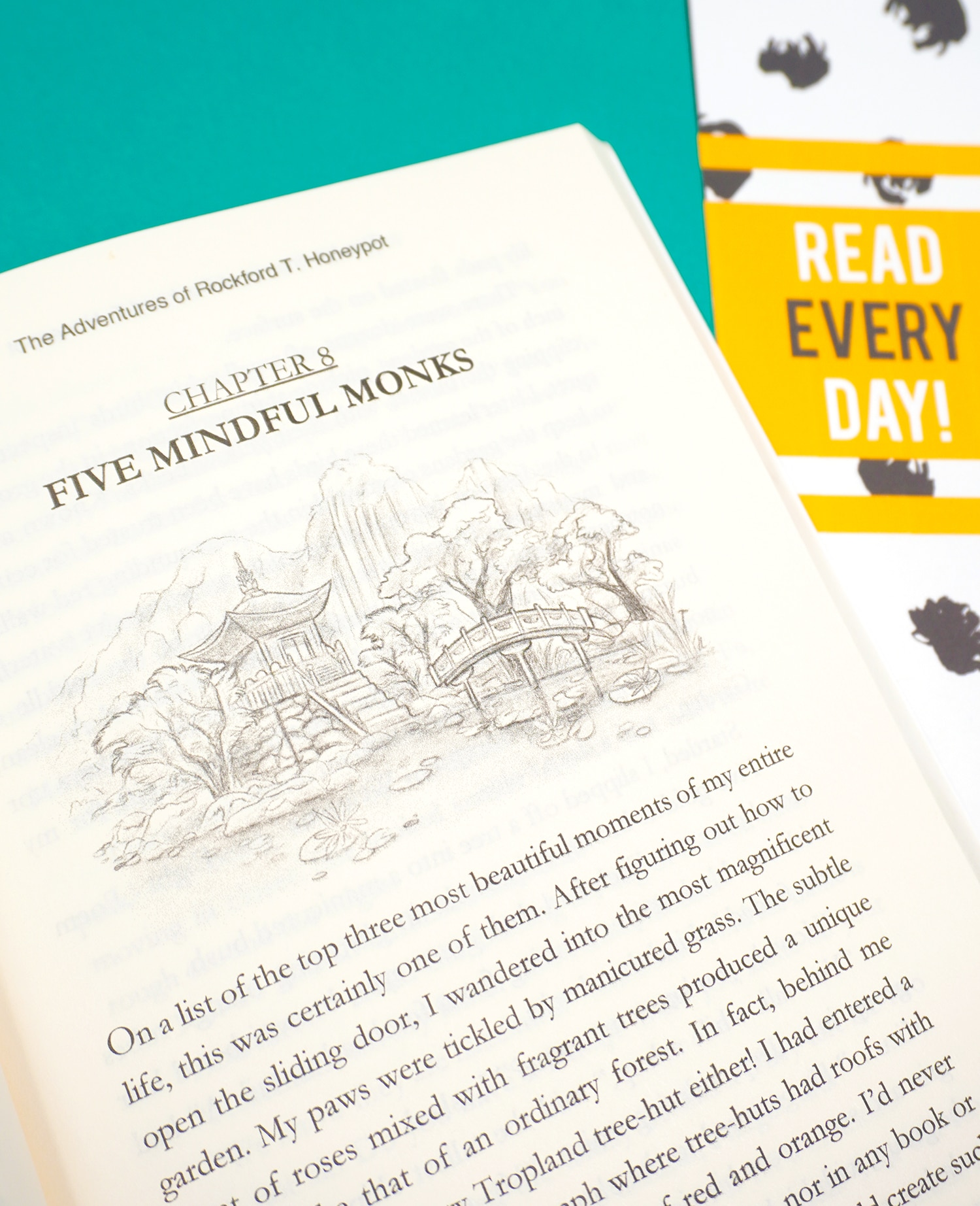 """A close up of book page and a \""""Read Every Day\"""" printable bookmark"""