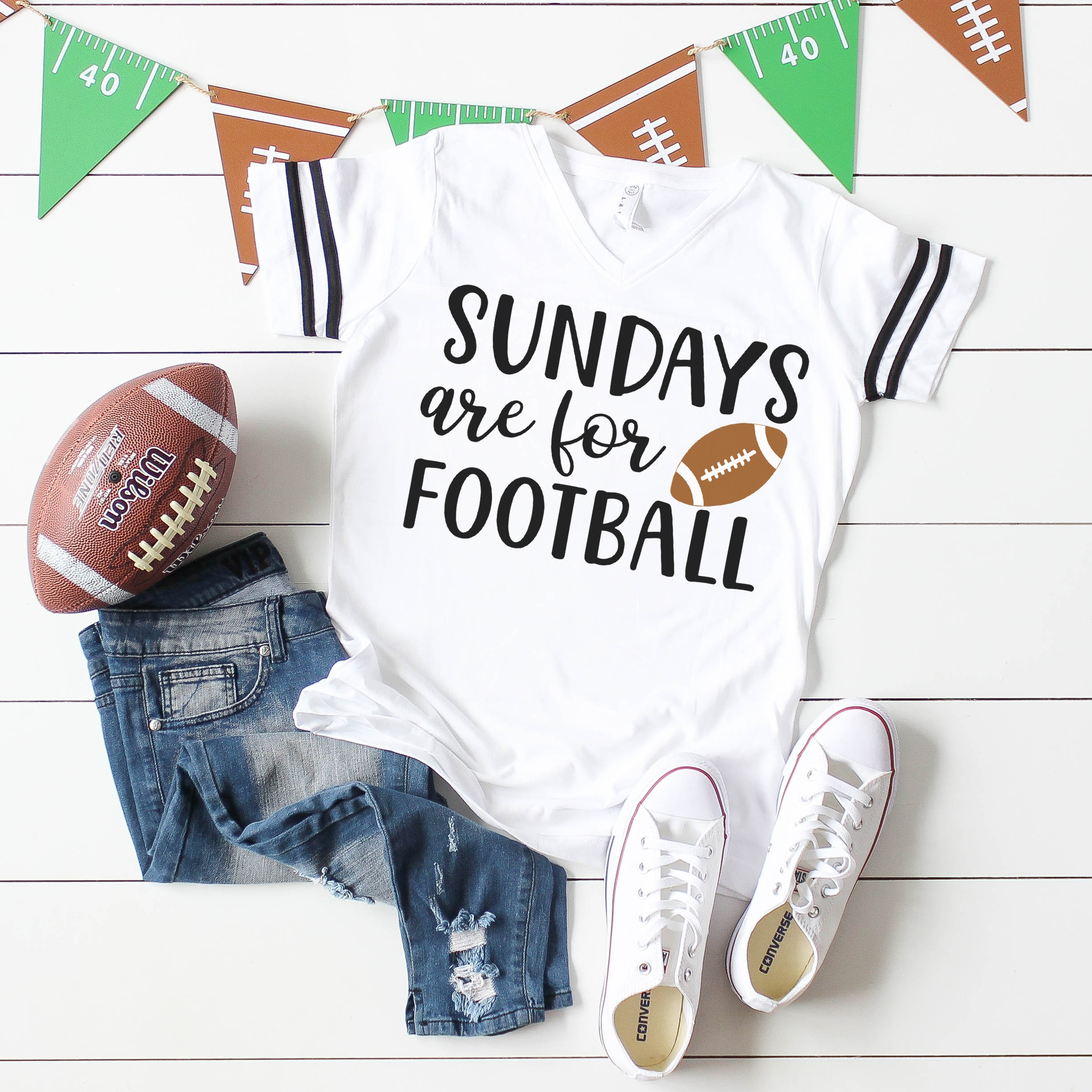 """""""Sundays are for Football"""" Shirt on white wood background with football, jeans, white shoes, and football banner"""