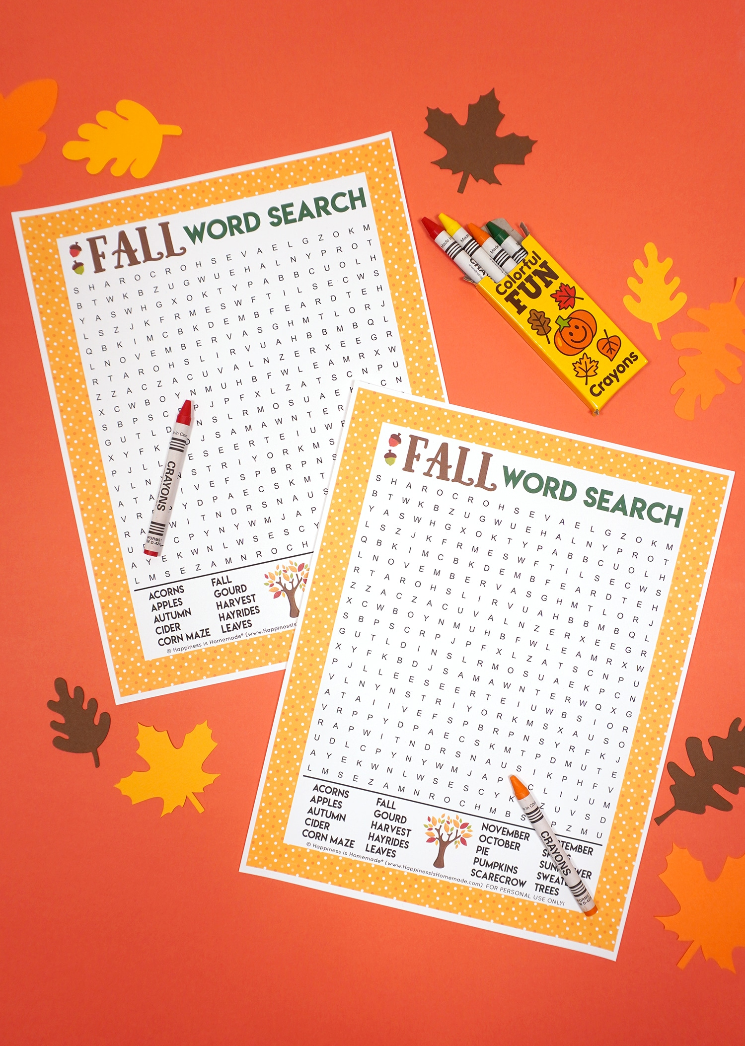 Fall Word Search Printable on dark orange background with box of crayons surrounded by paper leaves