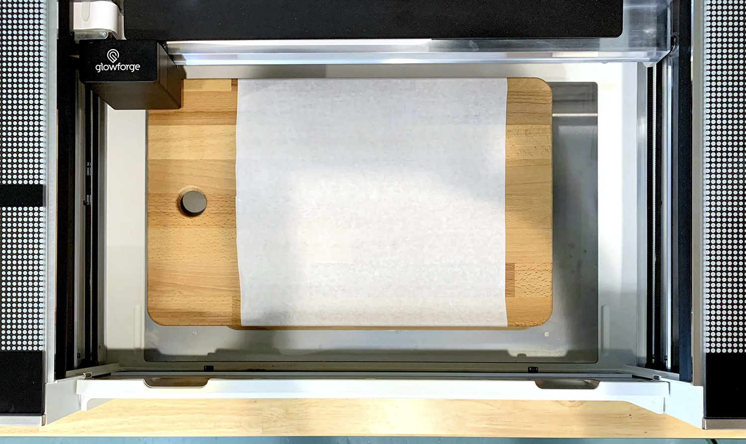Masked cutting board inside a Glowforge Pro machine