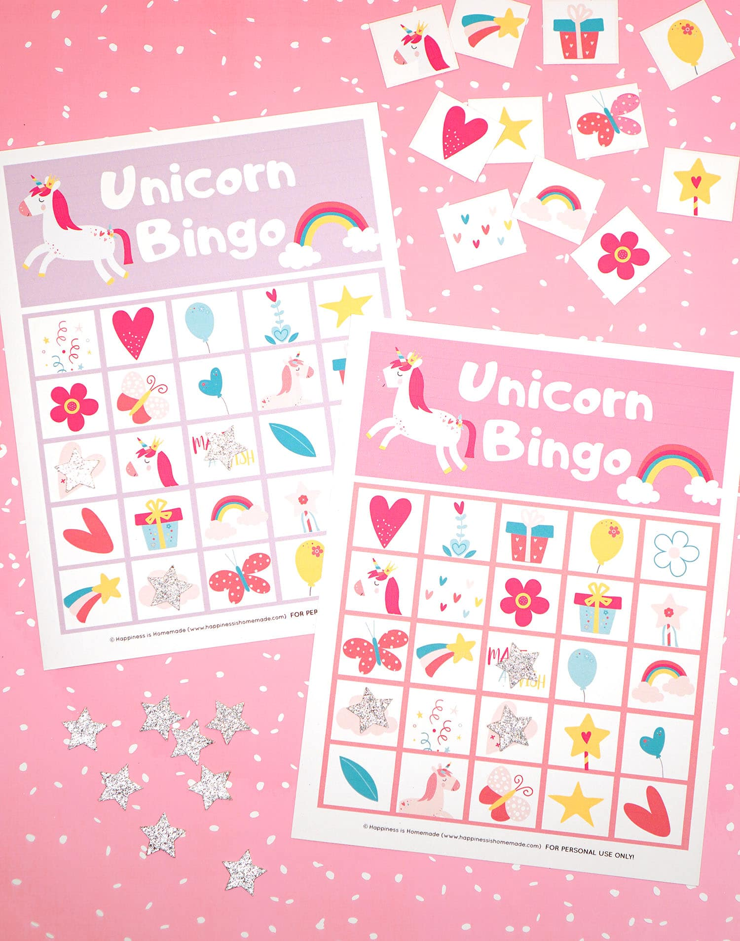 Printable Unicorn Bingo Game Cards on pink background with silver star markers and calling cards