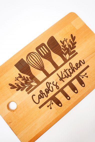 "Glowforge Engraved Ikea Cutting Board with ""Carol's Kitchen"" design on white background"