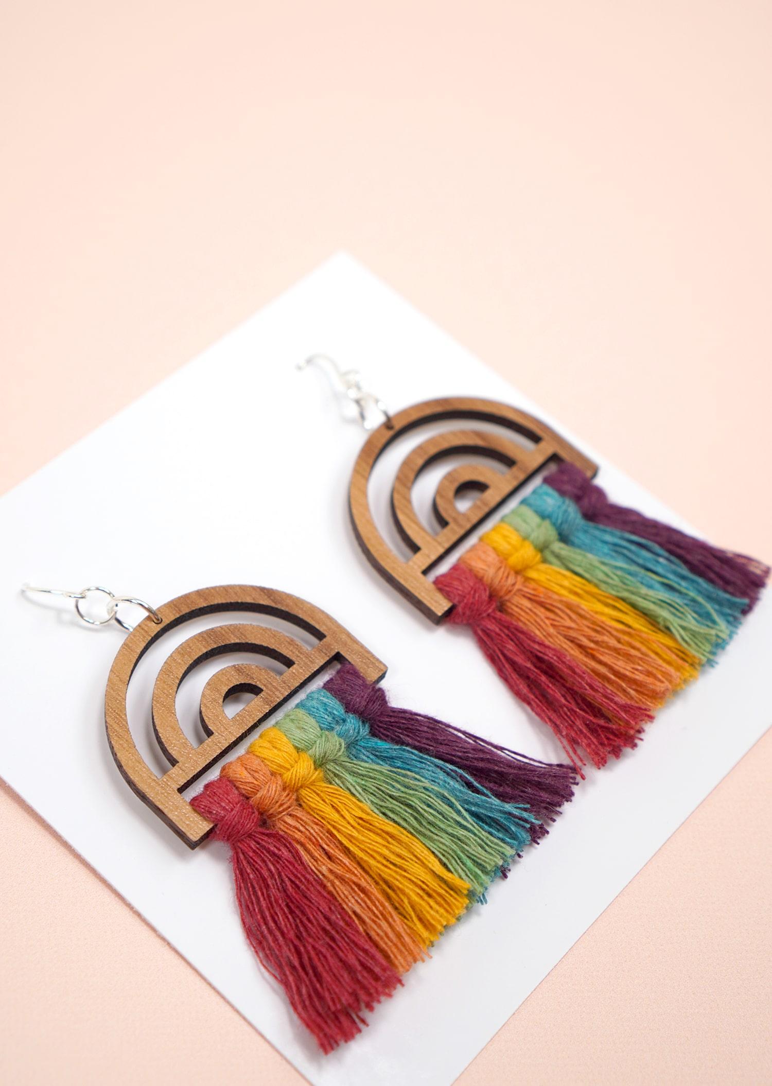 Rainbow Macrame Earrings with Wood Findings on peach background