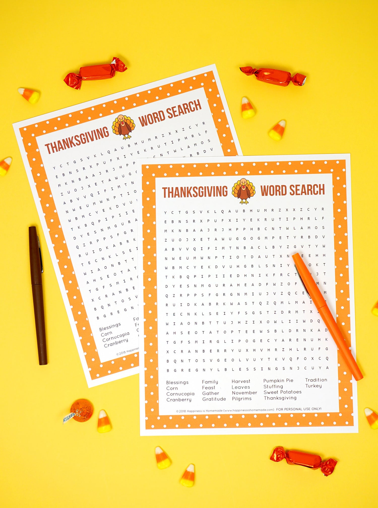 Two Printable Thanksgiving Word Search puzzle games on yellow background with brown & orange pens and candy