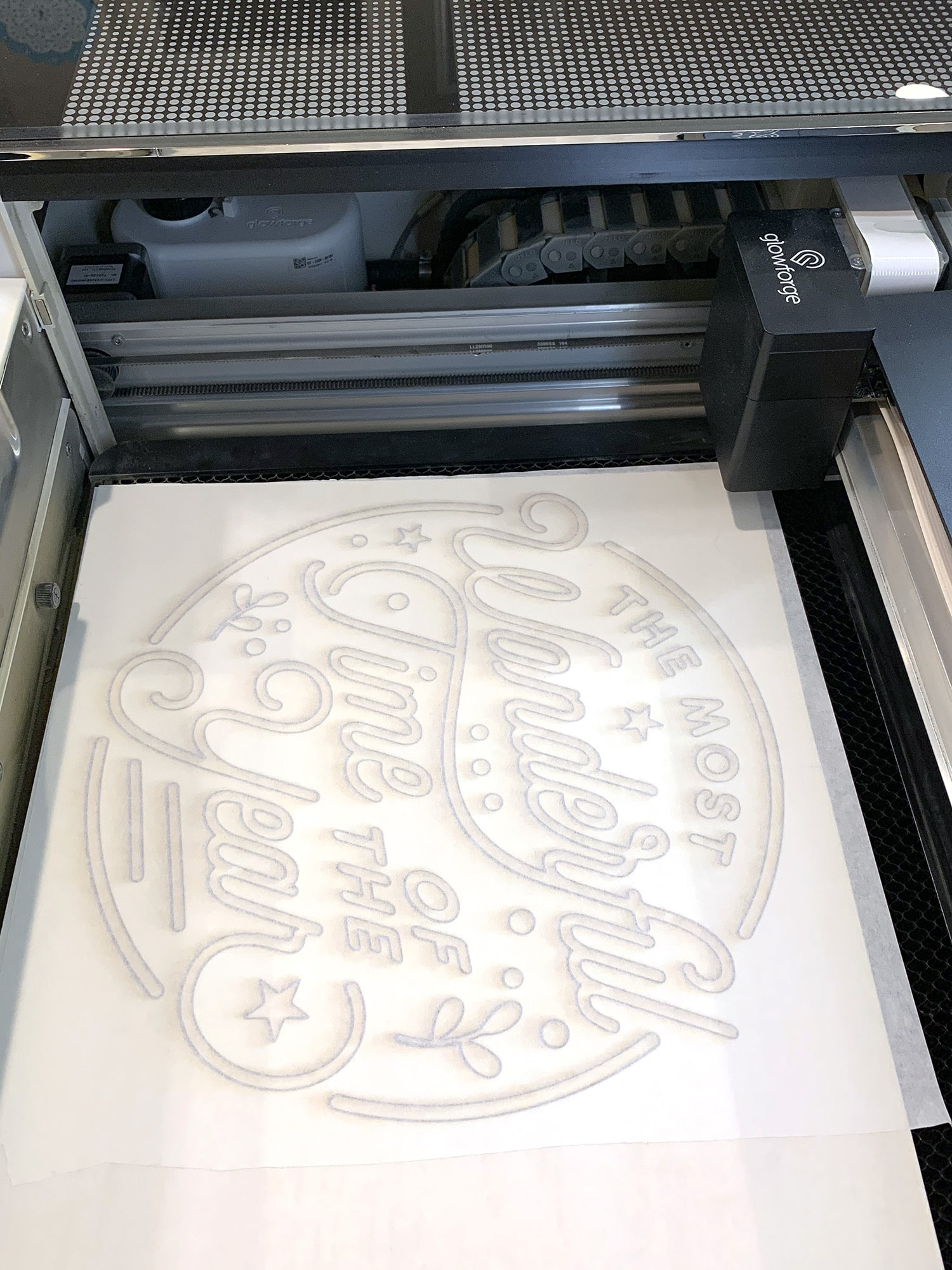 Laser Cut Wood Sign in Glowforge with second layer of masking adding to top of cut pieces