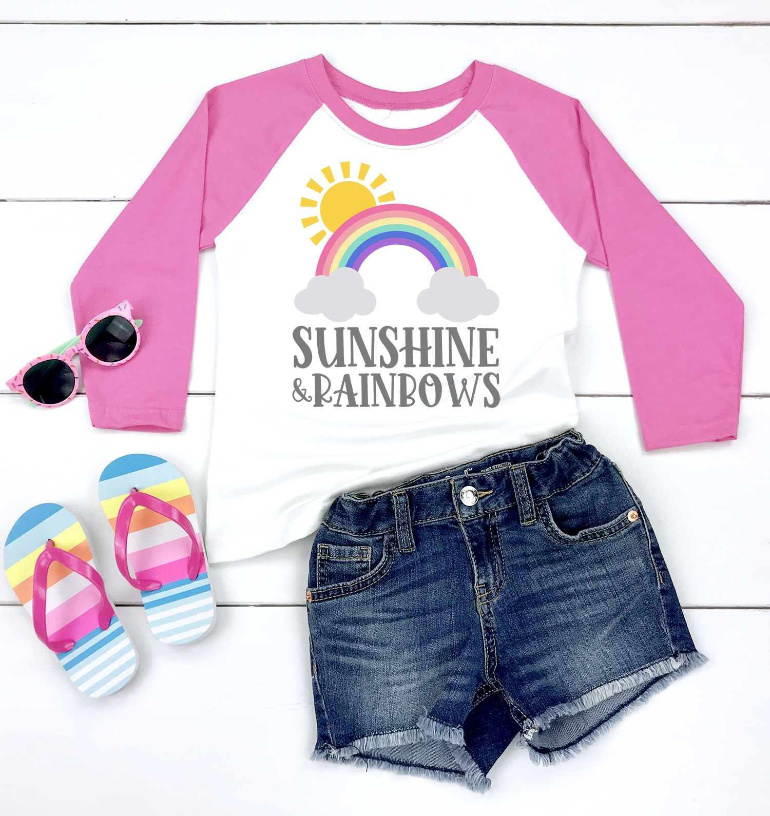 Sunshine and Rainbows pink raglan shirt with denim shorts, striped flip flops, and pink sunglasses