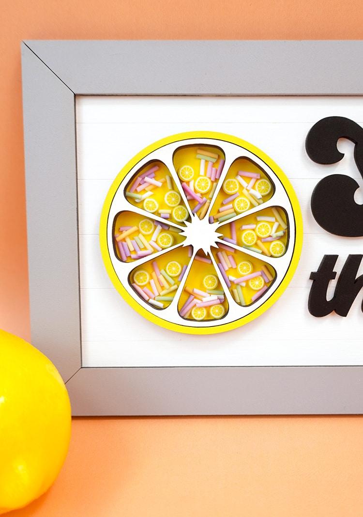 Lemon Shaker Sign close up detail on orange background