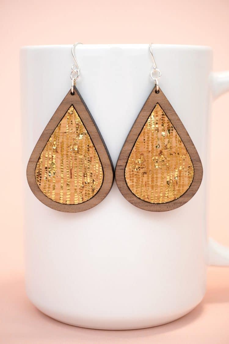 teardrop laser cut wood earrings with metallic gold dotted cork inlay