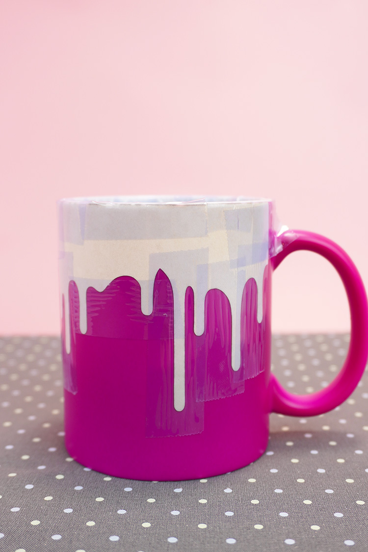 """Bright pink mug with """"Drippy"""" Infusible Ink design cooling on a polka dot mat"""