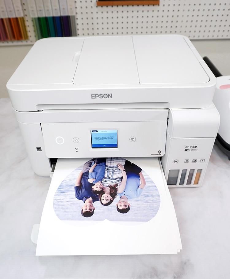 Epson EcoTank 4760 printer on desk with photo in printer tray