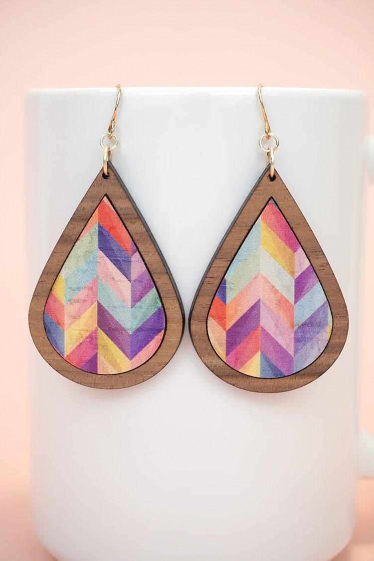 teardrop laser cut wood earrings with colorful herringbone patterned cork inlay