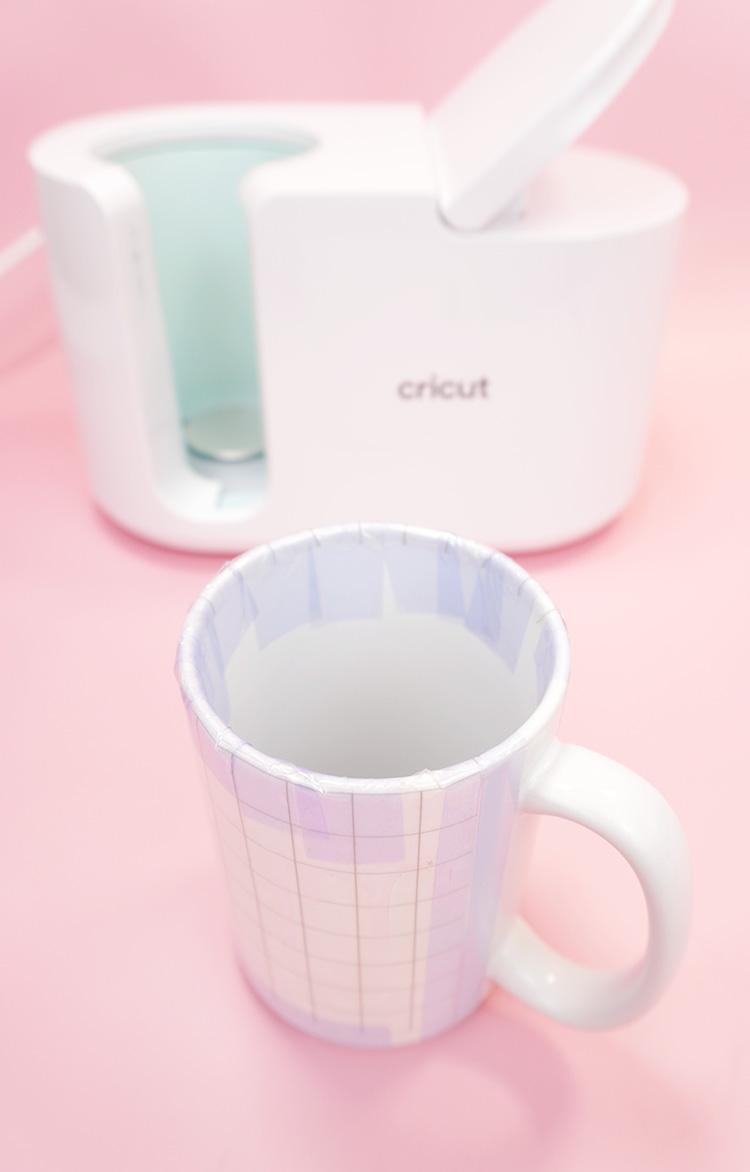 Cricut Mug with taped Infusible Ink mug wrap and Mug Press