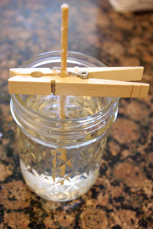 overhead view of clothespin holding a wooden skewer in place atop a mason jar