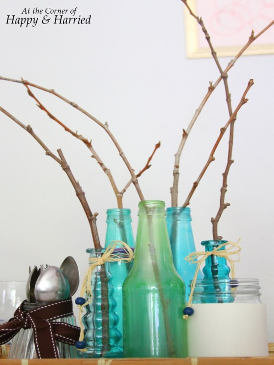 Pretty Centerpiece with colored bottles and twigs