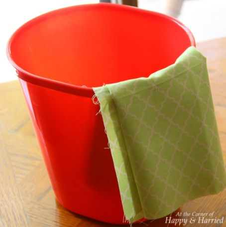 Red Trash Can and Green Fabric